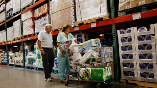 Customers shop at a Costco store.