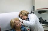 Dr. Martha Perez examines a patient at Community Health of South Florida.