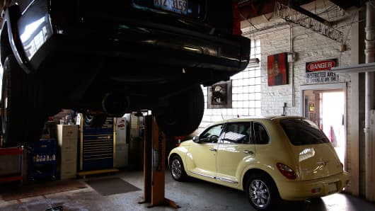 A car awaits repairs in the service department at