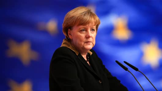 German Chancellor Angela Merkel, speaks in front of a flag of the European Union