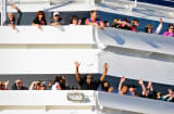 Passengers wave from the stranded Carnival Splendor 2010