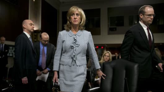 Ina Drew, former chief investment officer with JPMorgan Chase & Co., center, arrives to a Senate Permanent Subcommittee on Investigations hearing