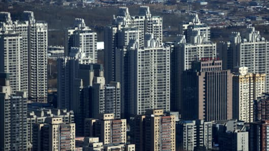 Residential buildings stand in Beijing