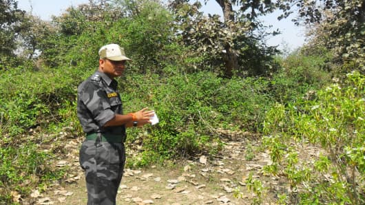 In this photograph taken on March 16, 2013, an Indian security official looks over the site where a Swiss woman was raped the night before near Gwalior, 342 kilometres from the state capital Bhopal.