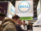 Visitors try out the latest laptop computers at the Dell stand at the 2013 CeBIT technology trade fair on March 5, 2013 in Hanover, Germany.