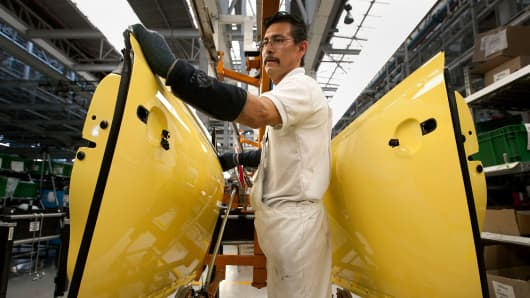 An employee works on the production line at a Volkswagen assembly plant in Puebla, Mexico.