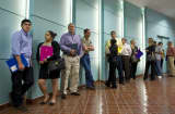 Job seekers wait for the opening of a job fair sponsored by Job News in partnership with USOilWorker.com and The Texas Veterans Commission in San Antonio, TX.