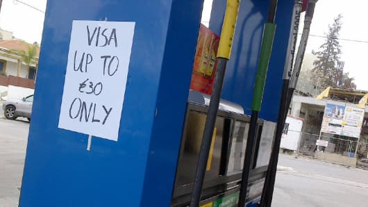 A sign on a Cyprus gas station limits customers to 30 euros to purchase gas.