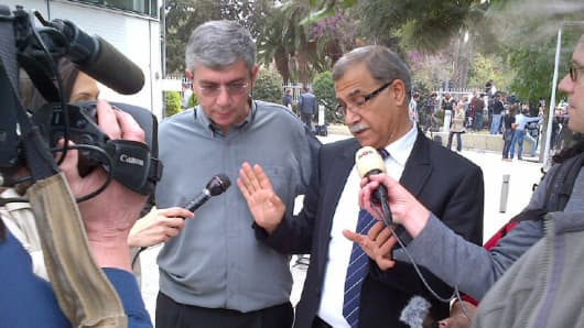 The head of the Cyprus Bank Workers Union arrives at parliament.