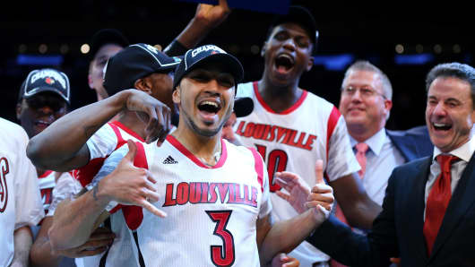 The Louisville Cardinals celebrate after winning against Syracuse during the final of the Big East Men's Basketball Tournament in March 2013.
