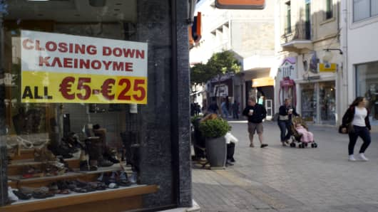 A shop displays a closing down sign in Nicosia, Cyprus.