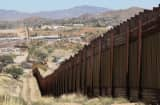 A fence separates the cities of Nogales, Arizona (L) and Nogales, Sonora Mexico.