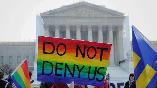 Supporters of same-sex marriage gather in front of the Supreme Court on Tuesday.