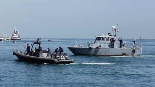 Egyptian coast guard vessels patrol the Suez Canal.