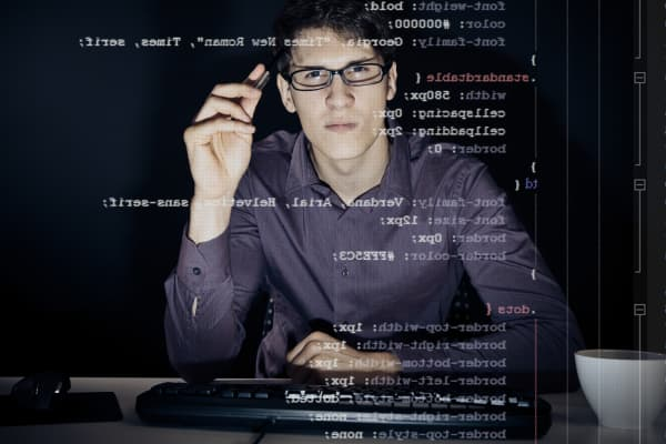 100610211-man-programming-code-on-screen
