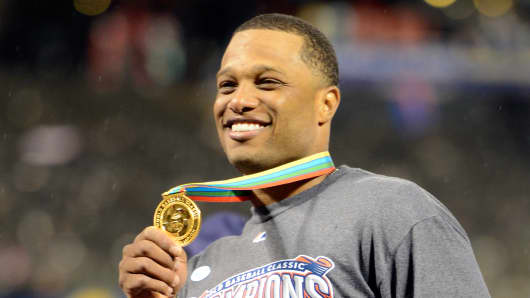 Robinson Cano #24 of the Dominican Republic celerbates after defeating Puerto Rico to win the Championship Round of the 2013 World Baseball Classic