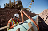 A weld inspector, fills out paperwork during construction of the Gulf Coast Project pipeline in Prague, Oklahoma, U.S.
