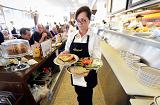 Waitress Sheila Abramson at Langer's Delicatessen serves customers in Los Angeles, California.