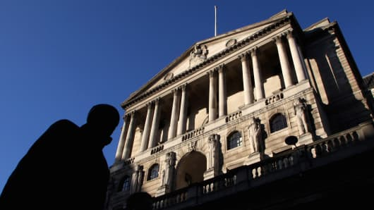 A city worker walks past the Bank of England in central London.