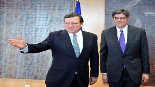 U.S. Treasury Secretary Jack Lew is shown the way by European Council President Jose Manuel Barroso on his first official visit to Europe.
