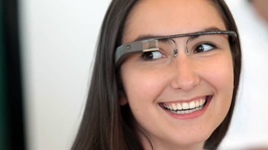 An employee wearing a pair of Google Glass