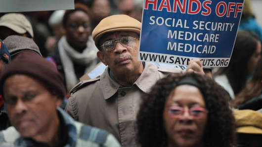 Demonstrators, including many senior citizens, protest in Chicago against cuts to federal safety net programs, including Social Security, Medicare and Medicaid.