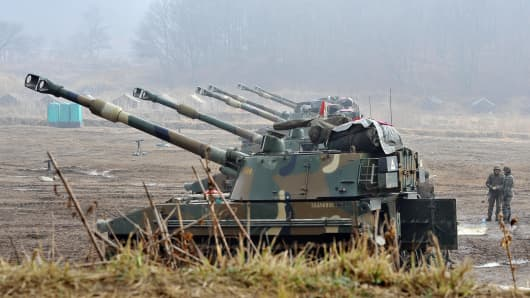 South Korean marines man K-55 self-propelled howitzers at a military training field in the border city of Paju on April 3, 2013.