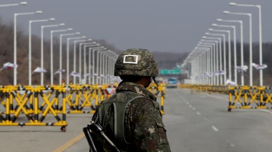 A South Korean soldier stands at a military check point connecting South and North Korea at the Unification Bridge in Paju, South Korea.