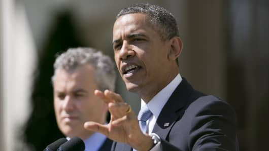 President Barack Obama, speaks in the Rose Garden of the White House with Jeffrey Zients, acting director of the Office of Managemen