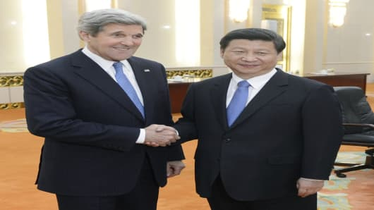 U.S. Secretary of State John Kerry shakes hands with Chinese President Xi Jinping before their meeting at the Great Hall of the People in Beijing on April 13, 2013.