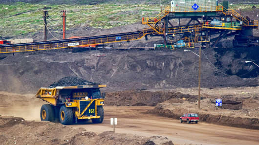 A Caterpillar Inc. mining truck carries a load at Syncrude Canada Ltd.'s oil sands North Mine in Fort McMurray, Alberta, Canada.
