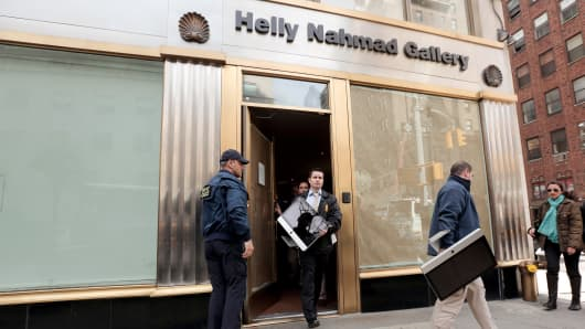 Federal agents remove computers from the Helly Nahmad Gallery at the Carlyle Hotel in New York.
