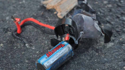 Boston Marathon bomb scene pictures taken by investigators show the remains of an explosive device.