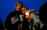 A young girl cries with her mother during the vigil for eight-year-old Martin Richard, from Dorchester, who was killed by an explosion near the finish line of the Boston Marathon on April 16, 2013 at Garvey Park in Boston, Massachusetts