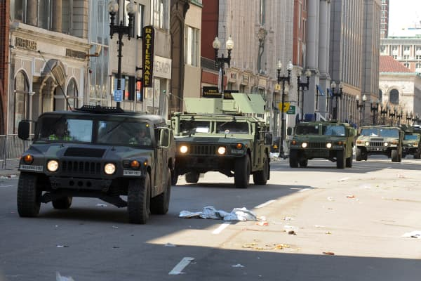 US military Humvees rolling down a deserted Boylston Street April 16, 2013, which is considered a crime scene after two explosions rocked the Boston Marathon on Monday.