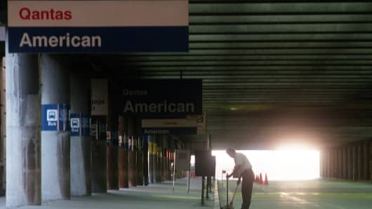 Logan Airport at 7 a.m., Terminal B.  Early morning light and a lone curb