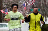 Runners in Watertown, Mass., with American flags and a Boston Strong T-shirt.