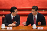 China&#039;s new President Xi Jinping (R) talks with former President Hu Jintao (L) on March 14, 2013 in Beijing, China.