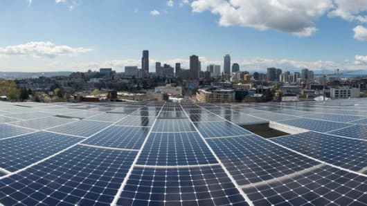 An array of 575 solar panels covers the roof of Seattle's Bullitt Center, a model for a new generation of sustainable, energy-efficient buildings.