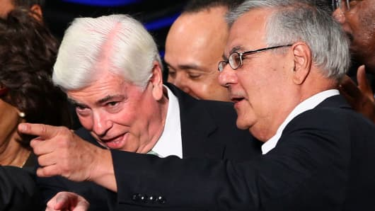 Rep. Barney Frank (R) (D-MA) and Sen. Chris Dodd (L) (D-CT) talk with each other after U.S. President Barack Obama signed the Dodd-Frank Wall Street Reform and Consumer Protection Act at the Ronald Reagan Building July 21, 2010 in Washington, DC.