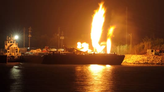 A large fire from two explosions on a fuel barge in Mobile, Alabama.