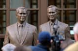 Statues of former Presidents George W. Bush (L) and his father George H.W. Bush are on display during a tour of the George W. Bush Presidential Library and Museum.