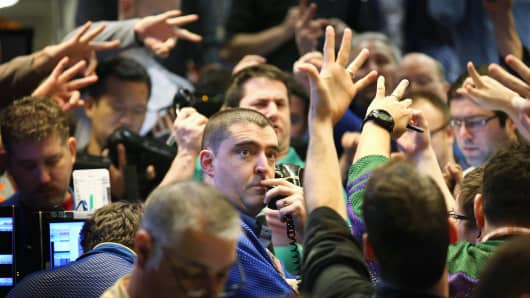 Traders signal offers in the Standard & Poor's 500 stock index options pit at the Chicago Board Options Exchange (CBOE).