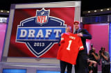 The NFL's overall draft pick, Eric Fisher with NFL Commissioner Roger Goodell.
