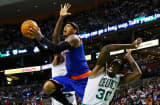 Carmelo Anthony #7 of the New York Knicks drives to the basket in front of Brandon Bass #30 of