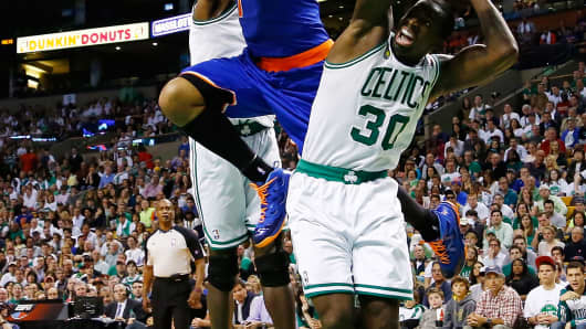 Carmelo Anthony #7 of the New York Knicks drives to the basket in front of Brandon Bass #30 of the Boston Celtics.