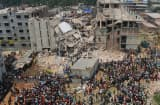 Volunteers and rescue workers at the scene after an eight-storey building collapsed in Savar, on the outskirts of Dhaka, in April.