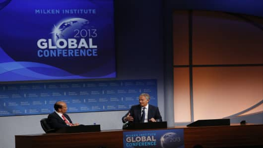 Michael Milken, chairman of the Milken Institute, left, listens during an interview with Tony Blair, former U.K. prime minister, at the Milken Institute Global Conference in Beverly Hills, California, U.S.