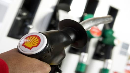 SHELL EXXON EARNS WRAP