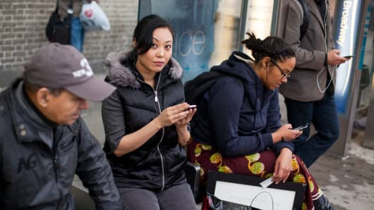 Rose Cha, second from left, who's had her cellphone stolen three times, in New York.